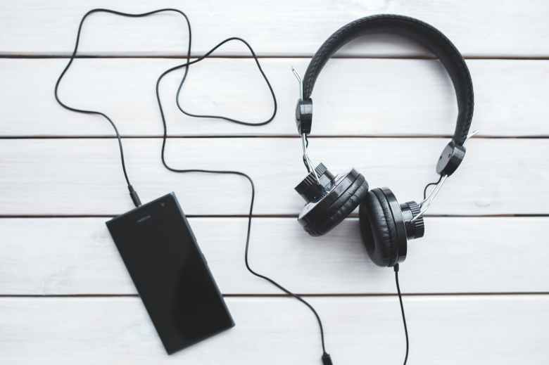 black headphones with mobile smartphone