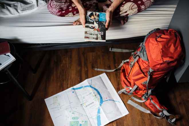 orange and gray hiking backpack on the floor
