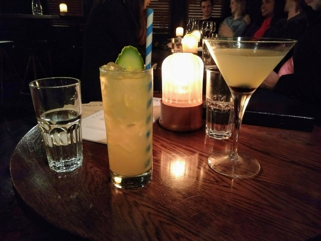 Drinks at a comedy gig - the best way to enjoy the nightlife when you're travelling solo.