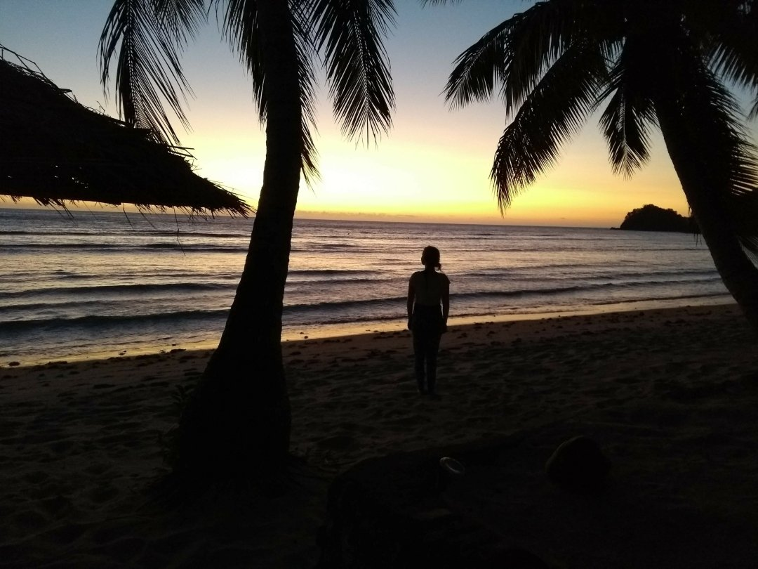 solo female travel - enjoying the beaches of Fiji alone at sunset.
