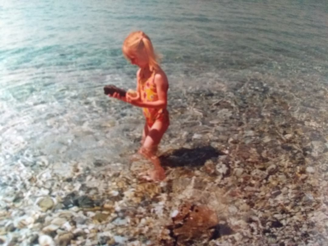 A girl playing in the sea in Greece.